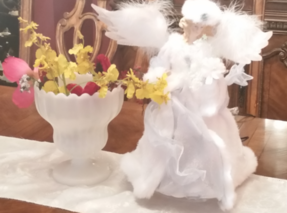 Angel and Flowers in Pitcher on Dining Room Table